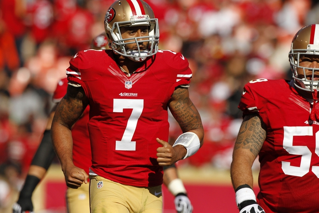 Sep 22, 2013; San Francisco, CA, USA; San Francisco 49ers quarterback Colin Kaepernick (7) jogs off the field after fumbling the ball against the Indianapolis Colts in the fourth quarter at Candlestick Park. The Colts defeated the 49ers 27-7. Mandatory Credit: Cary Edmondson-USA TODAY Sports