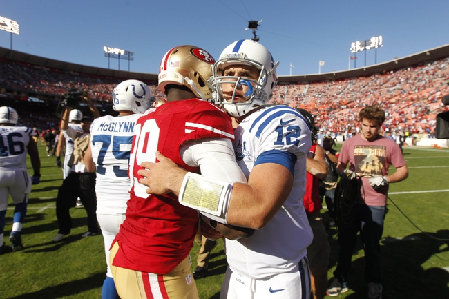 Sep 22, 2013; San Francisco, CA, USA; Indianapolis Colts quarterback Andrew Luck (12) meets with San Francisco 49ers outside linebacker Aldon Smith (99) after the Colts defeated the 49ers 27-7 at Candlestick Park. Mandatory Credit: Cary Edmondson-USA TODAY Sports
