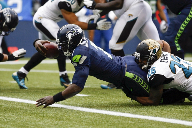 Sep 22, 2013; Seattle, WA, USA; Seattle Seahawks quarterback Tarvaris Jackson (7) rushes for a touchdown against the Jacksonville Jaguars during the fourth quarter at CenturyLink Field.  Mandatory Credit: Joe Nicholson-USA TODAY Sports