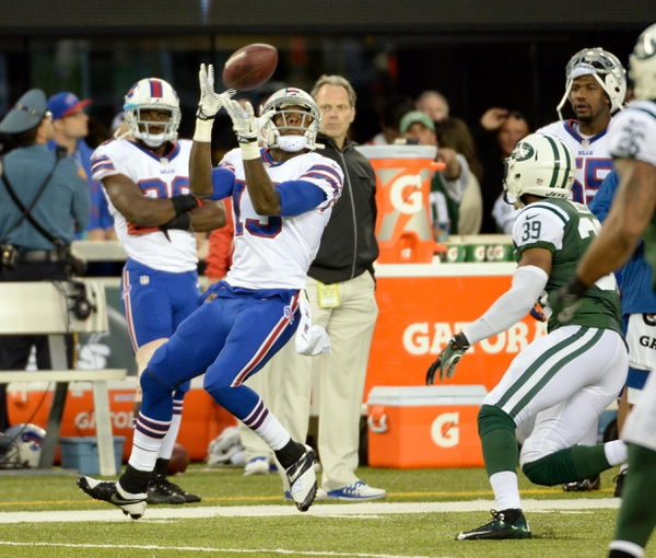 Sep 22, 2013; East Rutherford, NJ, USA; Buffalo Bills wide receiver Steve Johnson (13) catches a pass in the 3rd quarter against the New York Jets at MetLife Stadium. Mandatory Credit: Robert Deutsch-USA TODAY Sports