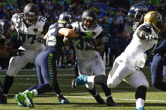 Sep 22, 2013; Seattle, WA, USA; Jacksonville Jaguars running back Maurice Jones-Drew (32) rushes for a touchdown against the Seattle Seahawks during the third quarter at CenturyLink Field.  Mandatory Credit: Joe Nicholson-USA TODAY Sports