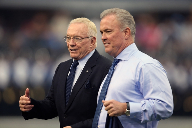 Sep 22, 2013; Arlington, TX, USA; Dallas Cowboys owner Jerry Jones talks with son executive vice president Stephen Jones during halftime against the St. Louis Rams at AT&T Stadium. Mandatory Credit: Matthew Emmons-USA TODAY Sports
