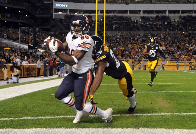 Sep 22, 2013; Pittsburgh, PA, USA; Chicago Bears wide receiver Earl Bennett (80) catches a touchdown pass in front of Pittsburgh Steelers safety Shamarko Thomas (29) during the second half at Heinz Field. The Bears won the game, 40-23. Mandatory Credit: Jason Bridge-USA TODAY Sports