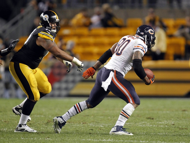 Sep 22, 2013; Pittsburgh, PA, USA; Chicago Bears defensive end Julius Peppers (90) returns a fumble for a forty two yard touchdown against the Pittsburgh Steelers during the fourth quarter at Heinz Field. The Bears won 40-23. Mandatory Credit: Charles LeClaire-USA TODAY Sports