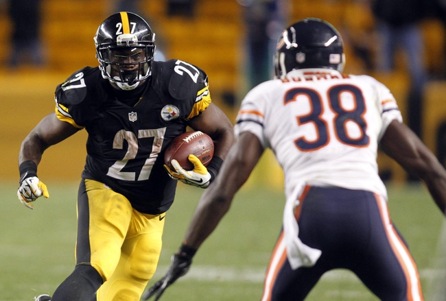 Sep 22, 2013; Pittsburgh, PA, USA; Pittsburgh Steelers running back Jonathan Dwyer (27) carries the ball as Chicago Bears defensive back Zack Bowman (38) defends during the fourth quarter at Heinz Field. The Bears won 40-23. Mandatory Credit: Charles LeClaire-USA TODAY Sports