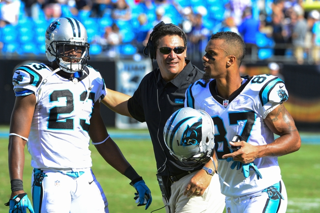 Sep 22, 2013; Charlotte, NC, USA; Carolina Panthers head coach Ron Rivera, center, with cornerback Melvin White (23) and wide receiver Domenik Hixon (87) late in the fourth quarter. The Panthers defeated the New York Giants 38-0 at Bank of America Stadium. Mandatory Credit: Bob Donnan-USA TODAY Sports