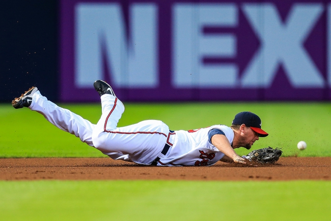 Sep 23, 2013; Atlanta, GA, USA; Atlanta Braves third baseman Chris Johnson (23) misses a diving attempt for a ground ball in the first inning against the Milwaukee Brewers at Turner Field. Mandatory Credit: Daniel Shirey-USA TODAY Sports