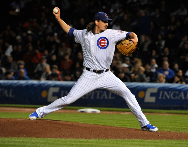 Sep 23, 2013; Chicago, IL, USA; Chicago Cubs starting pitcher Jeff Samardzija (29) pitches against the Pittsburgh Pirates during the first inning at Wrigley Field. Mandatory Credit: David Banks-USA TODAY Sports