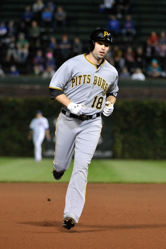 Sep 23, 2013; Chicago, IL, USA; Pittsburgh Pirates second baseman Neil Walker (18) runs the bases after hitting a home run against the Chicago Cubs during the first inning at Wrigley Field. Mandatory Credit: David Banks-USA TODAY Sports