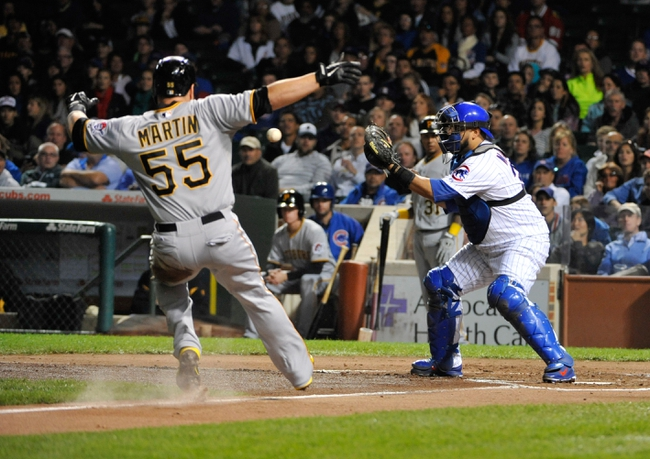 Sep 23, 2013; Chicago, IL, USA; Pittsburgh Pirates catcher Russell Martin (55) tries to stop before getting tagged out by Chicago Cubs catcher Dioner Navarro (30) during the second inning at Wrigley Field. Mandatory Credit: David Banks-USA TODAY Sports