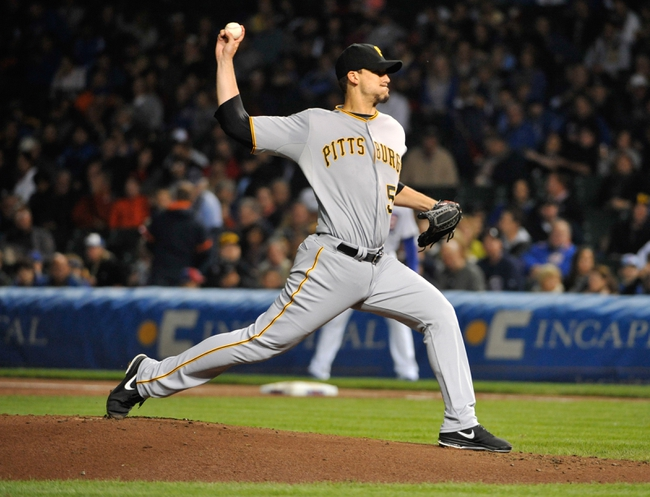 Sep 23, 2013; Chicago, IL, USA; Pittsburgh Pirates starting pitcher Charlie Morton (50) pitches against the Chicago Cubs during the first inning at Wrigley Field. Mandatory Credit: David Banks-USA TODAY Sports