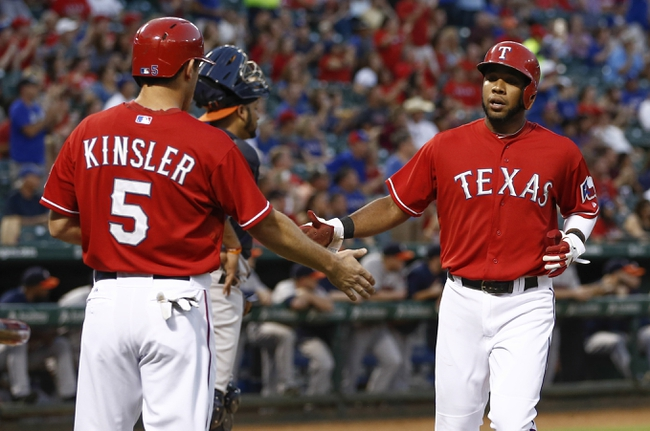 Sep 23, 2013; Arlington, TX, USA; Texas Rangers second baseman Ian Kinsler (5) congratulates shortstop Elvis Andrus (1) after both scored against the Houston Astros on a double hit by Alex Rios during the first inning of a baseball game at Rangers Ballpark in Arlington. Mandatory Credit: Jim Cowsert-USA TODAY Sports
