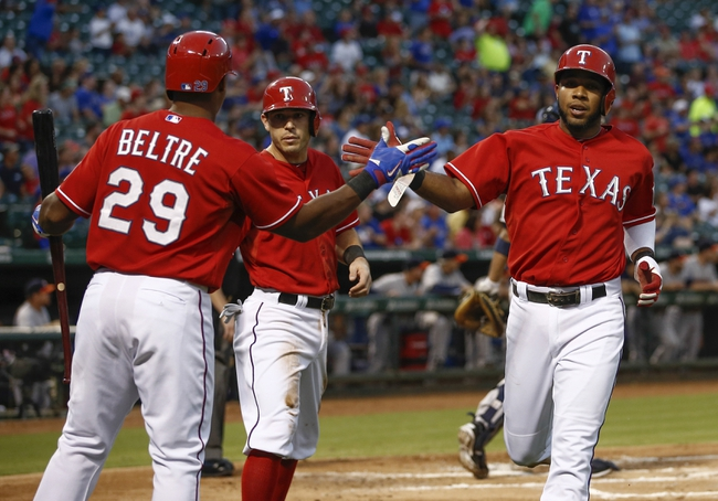 Sep 23, 2013; Arlington, TX, USA; Texas Rangers third baseman Adrian Beltre (29) congratulates shortstop Elvis Andrus (1) and second baseman Ian Kinsler (5) after their runs scored against the Houston Astros on a double hit by Alex Rios during the first inning of a baseball game at Rangers Ballpark in Arlington. Mandatory Credit: Jim Cowsert-USA TODAY Sports