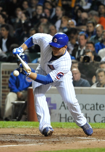 Sep 23, 2013; Chicago, IL, USA; Chicago Cubs first baseman Anthony Rizzo (44) attempts a bunt against the Pittsburgh Pirates during the fourth inning at Wrigley Field. Mandatory Credit: David Banks-USA TODAY Sports