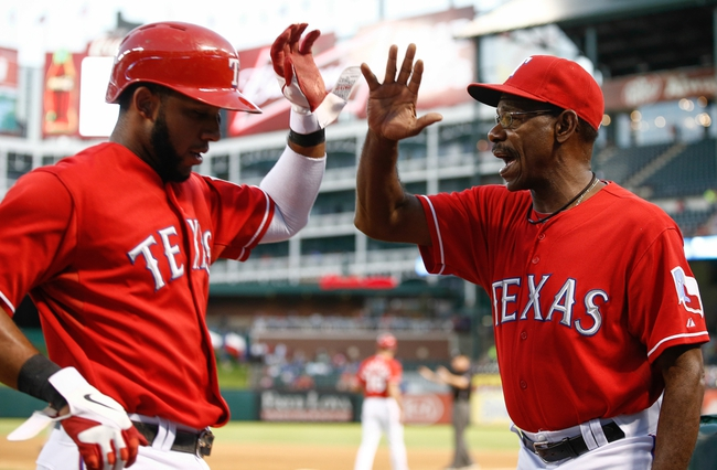 Sep 23, 2013; Arlington, TX, USA; Texas Rangers shortstop Elvis Andrus (left) is congratulated by manager Ron Washington (right) after scoring a run against the Houston Astros during the first inning of a baseball game at Rangers Ballpark in Arlington. Mandatory Credit: Jim Cowsert-USA TODAY Sports