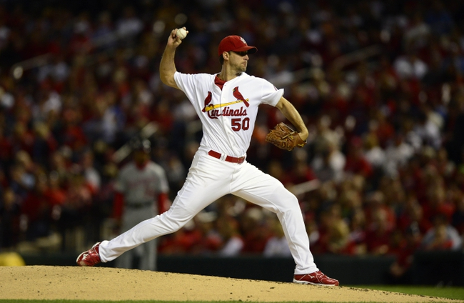 Sep 23, 2013; St. Louis, MO, USA; St. Louis Cardinals starting pitcher Adam Wainwright (50) throws to a Washington Nationals batter during the second inning at Busch Stadium. Mandatory Credit: Jeff Curry-USA TODAY Sports