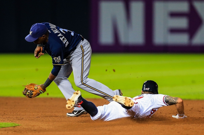 Sep 23, 2013; Atlanta, GA, USA; Atlanta Braves center fielder Jordan Schafer (17) steals second before Milwaukee Brewers second baseman Yuniesky Betancourt (3) can make the tag in the fourth inning at Turner Field. Mandatory Credit: Daniel Shirey-USA TODAY Sports