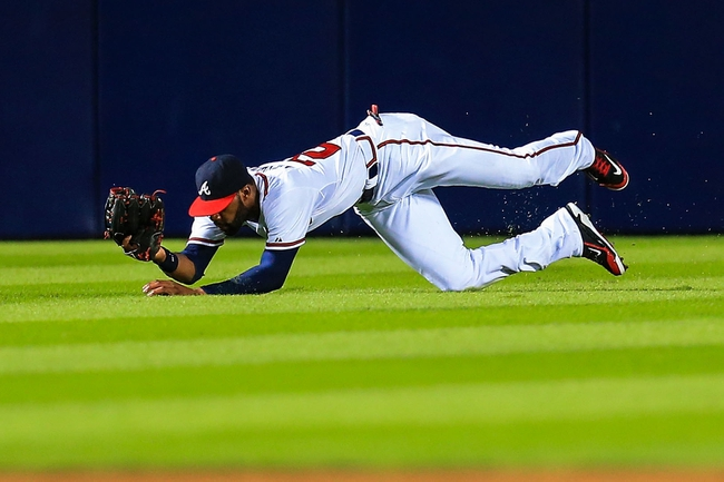 Sep 23, 2013; Atlanta, GA, USA; Atlanta Braves right fielder Jason Heyward (22) makes a diving catch in the fifth inning against the Milwaukee Brewers at Turner Field. Mandatory Credit: Daniel Shirey-USA TODAY Sports