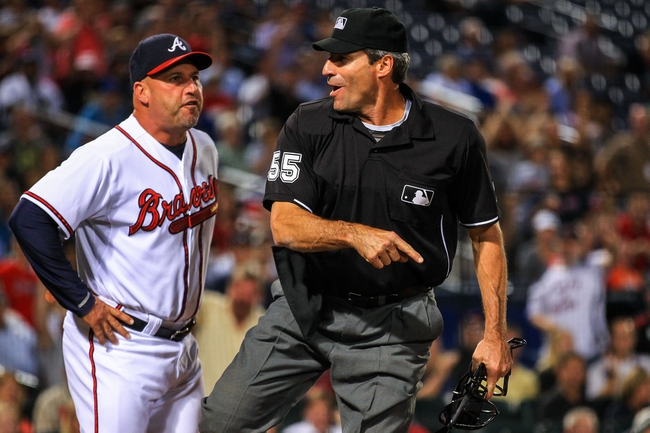 Sep 23, 2013; Atlanta, GA, USA; Atlanta Braves manager Fredi Gonzalez (33) is thrown out by home plate umpire Angel Ramirez (55) in the seventh inning against the Milwaukee Brewers at Turner Field. Mandatory Credit: Daniel Shirey-USA TODAY Sports