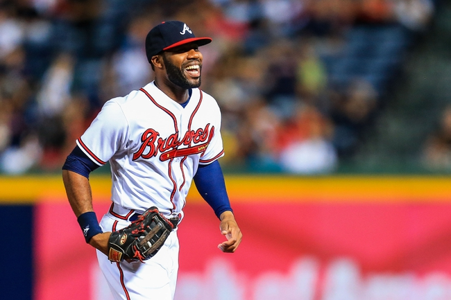 Sep 23, 2013; Atlanta, GA, USA; Atlanta Braves right fielder Jason Heyward (22) reacts to making a diving catch in the fifth inning against the Milwaukee Brewers at Turner Field. Mandatory Credit: Daniel Shirey-USA TODAY Sports