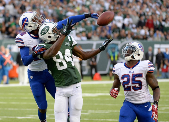 Sep 22, 2013; East Rutherford, NJ, USA; Buffalo Bills defensive back Justin Rogers (26) tips away a pass for New York Jets wide receiver Stephen Hill (84) during the first half at MetLife Stadium. Mandatory Credit: Robert Deutsch-USA TODAY Sports