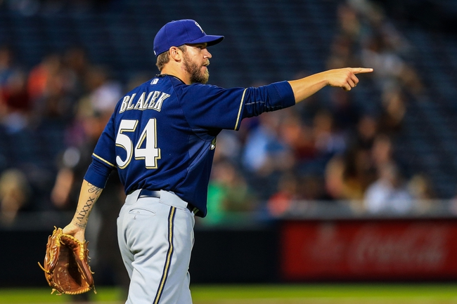 Sep 23, 2013; Atlanta, GA, USA; Milwaukee Brewers relief pitcher Michael Blazek (54) celebrates beating the Atlanta Braves at Turner Field. The Brewers won 5-0. Mandatory Credit: Daniel Shirey-USA TODAY Sports