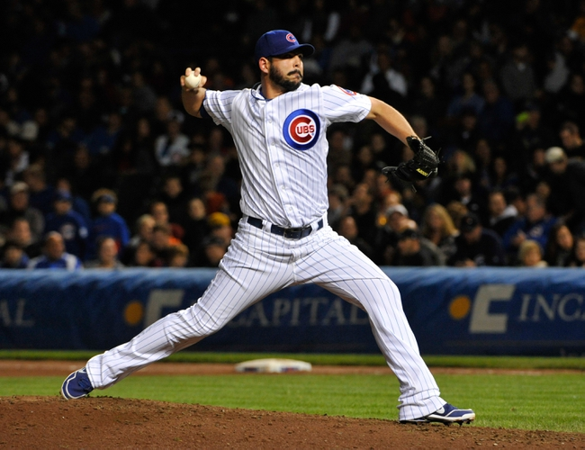 Sep 23, 2013; Chicago, IL, USA; Chicago Cubs relief pitcher Carlos Villanueva (33) pitches against the Pittsburgh Pirates during the seventh inning at Wrigley Field. Mandatory Credit: David Banks-USA TODAY Sports