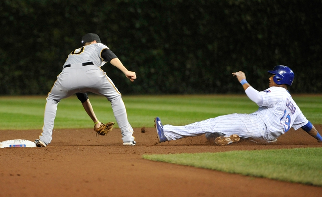 Sep 23, 2013; Chicago, IL, USA; Chicago Cubs shortstop Starlin Castro (13) is tagged out by Pittsburgh Pirates shortstop Jordy Mercer (10) during the sixth inning at Wrigley Field. Mandatory Credit: David Banks-USA TODAY Sports