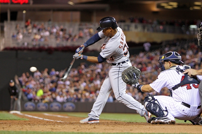 Sep 23, 2013; Minneapolis, MN, USA; Detroit Tigers shortstop Ramon Santiago (39) hits a single during the fifth inning against the Minnesota Twins at Target Field. Mandatory Credit: Brace Hemmelgarn-USA TODAY Sports