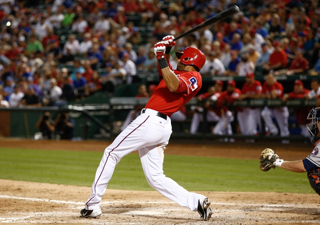 Sep 23, 2013; Arlington, TX, USA; Texas Rangers right fielder Alex Rios (51) follows through for a triple against the Houston Astros during the sixth inning completing the cycle of a baseball game at Rangers Ballpark in Arlington. Rios is the seventh in Rangers history to hit for the cycle. Mandatory Credit: Jim Cowsert-USA TODAY Sports