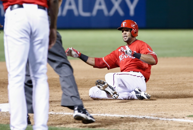 Sep 23, 2013; Arlington, TX, USA; Texas Rangers right fielder Alex Rios (51) slides to third base ahead for the throw to Houston Astros shortstop Marwin Gonzalez (9) completing the cycle during the sixth inning of a baseball game at Rangers Ballpark in Arlington. Rios is the seventh in Rangers history to hit for the cycle. Mandatory Credit: Jim Cowsert-USA TODAY Sports