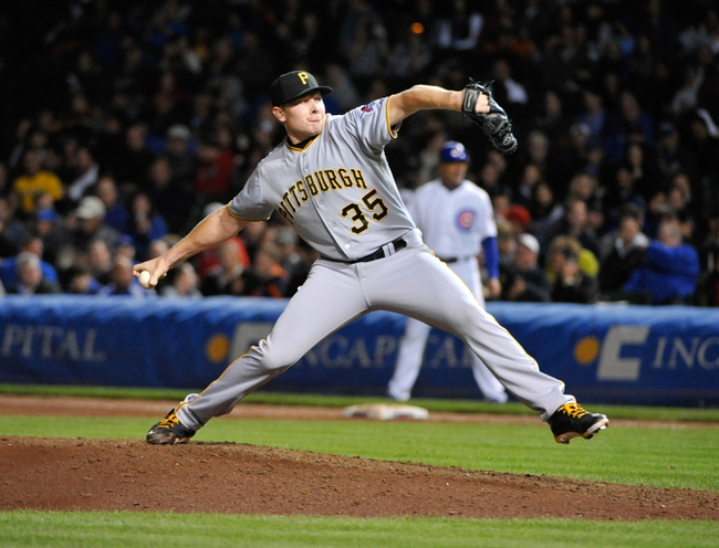 Sep 23, 2013; Chicago, IL, USA; Pittsburgh Pirates relief pitcher Mark Melancon (35) pitches against the Chicago Cubs during the eighth inning at Wrigley Field. Mandatory Credit: David Banks-USA TODAY Sports