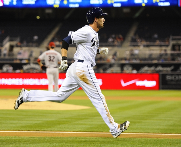Sep 23, 2013; San Diego, CA, USA; San Diego Padres right fielder Chris Denorfia (13) scores on a single by third baseman Chase Headley (not pictured) during the first inning against the Arizona Diamondbacks at Petco Park. Mandatory Credit: Christopher Hanewinckel-USA TODAY Sports