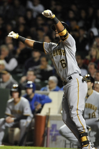 Sep 23, 2013; Chicago, IL, USA; Pittsburgh Pirates left fielder Starling Marte (6) watches his go ahead home run against the Chicago Cubs during the ninth inning at Wrigley Field. Mandatory Credit: David Banks-USA TODAY Sports