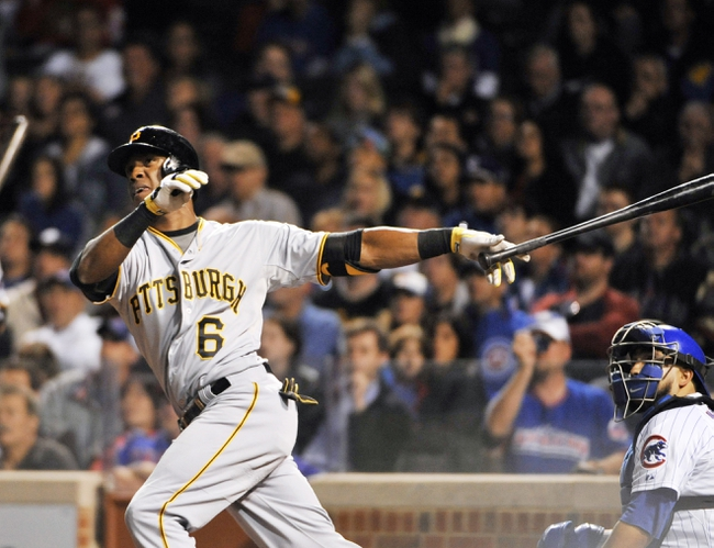 Sep 23, 2013; Chicago, IL, USA; Pittsburgh Pirates left fielder Starling Marte (6) hits a go ahead home run against the Chicago Cubs during the ninth inning at Wrigley Field. Mandatory Credit: David Banks-USA TODAY Sports