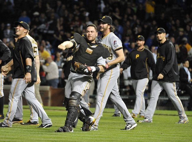 Sep 23, 2013; Chicago, IL, USA; Pittsburgh Pirates catcher Russell Martin (55) celebrates with his teammates their win against the Chicago Cubs at Wrigley Field. The Pittsburgh Pirates defeated the Chicago Cubs 2-1.Mandatory Credit: David Banks-USA TODAY Sports