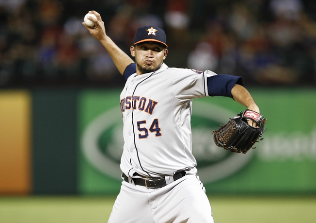 Sep 23, 2013; Arlington, TX, USA; Houston Astros relief pitcher David Martinez (54) delivers a pitch to the Texas Rangers during the sixth inning of a baseball game at Rangers Ballpark in Arlington. Mandatory Credit: Jim Cowsert-USA TODAY Sports