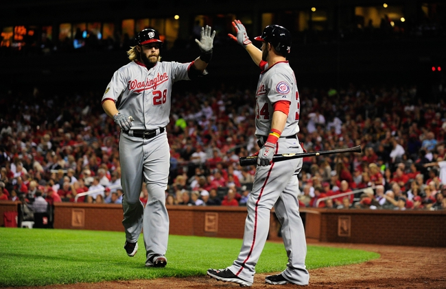 Sep 23, 2013; St. Louis, MO, USA; Washington Nationals right fielder Jayson Werth (28) is congratulated by left fielder Bryce Harper (34) after hitting a two run home run off of St. Louis Cardinals starting pitcher Adam Wainwright (not pictured) during the first inning at Busch Stadium. St. Louis defeated Washington 4-3. Mandatory Credit: Jeff Curry-USA TODAY Sports`