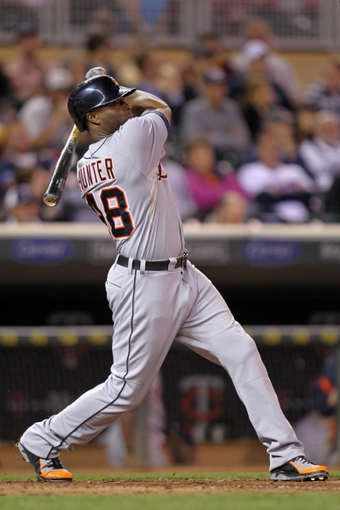 Sep 23, 2013; Minneapolis, MN, USA; Detroit Tigers outfielder Torii Hunter (48) hits a double during the seventh inning against the Minnesota Twins at Target Field. Mandatory Credit: Brace Hemmelgarn-USA TODAY Sports