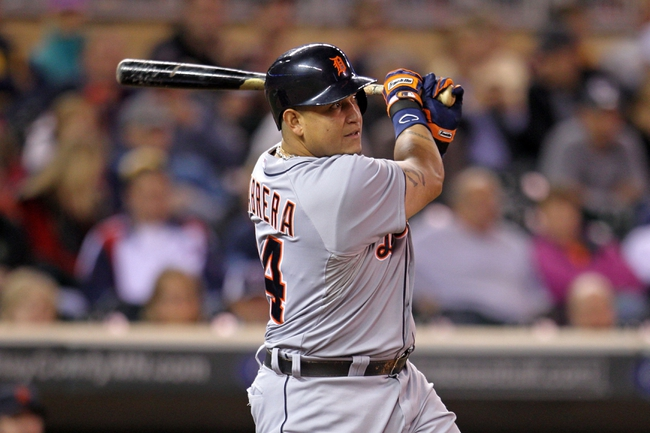 Sep 23, 2013; Minneapolis, MN, USA; Detroit Tigers third baseman Miguel Cabrera (24) hits a RBI single during the seventh inning against the Minnesota Twins at Target Field. Mandatory Credit: Brace Hemmelgarn-USA TODAY Sports