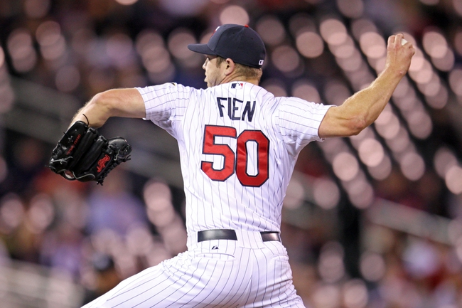 Sep 23, 2013; Minneapolis, MN, USA; Minnesota Twins pitcher Casey Fien (50) delivers a pitch during the seventh inning against the Detroit Tigers at Target Field. Mandatory Credit: Brace Hemmelgarn-USA TODAY Sports