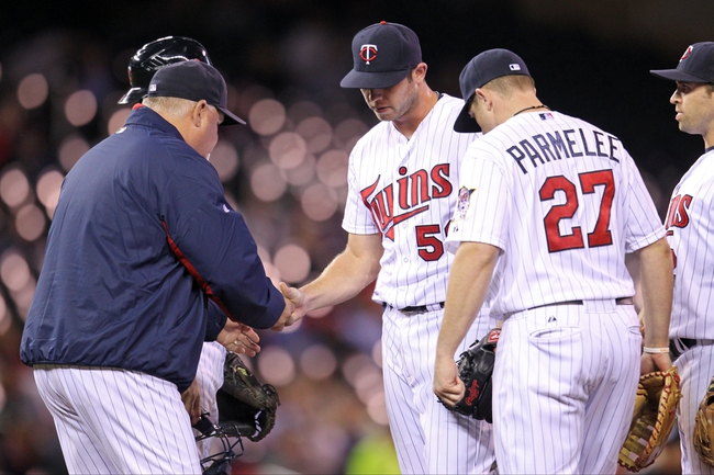 Sep 23, 2013; Minneapolis, MN, USA; Minnesota Twins pitcher Casey Fien (50) is removed from the game by manager Ron Gardenhire (35) during the seventh inning against the Detroit Tigers at Target Field. Mandatory Credit: Brace Hemmelgarn-USA TODAY Sports