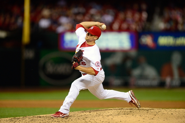 Sep 23, 2013; St. Louis, MO, USA; St. Louis Cardinals relief pitcher Trevor Rosenthal (26) throws to a Washington Nationals batter during the ninth inning at Busch Stadium. St. Louis defeated Washington 4-3. Mandatory Credit: Jeff Curry-USA TODAY Sports