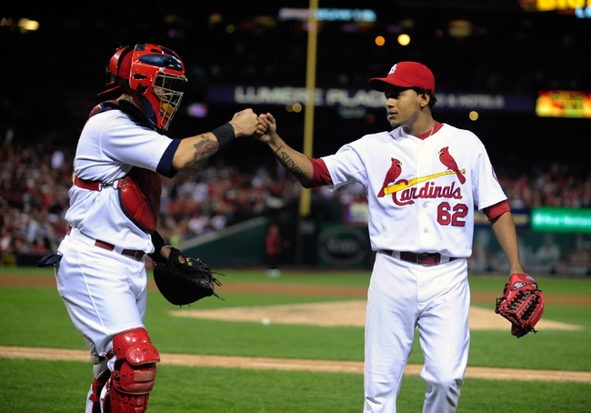 Sep 23, 2013; St. Louis, MO, USA; St. Louis Cardinals relief pitcher Carlos Martinez (62) is congratulated by catcher Yadier Molina (4) after getting out of the eighth inning against the Washington Nationals at Busch Stadium. St. Louis defeated Washington 4-3. Mandatory Credit: Jeff Curry-USA TODAY Sports