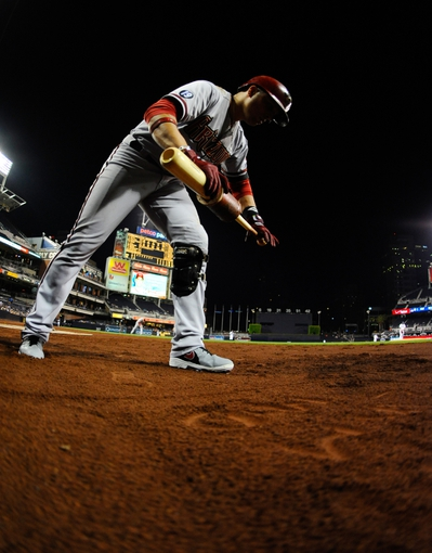 Sep 23, 2013; San Diego, CA, USA; Arizona Diamondbacks left fielder Martin Prado (14) writes a message in the dirt near the on deck circle prior to an at bat in the third inning against the San Diego Padres at Petco Park. Mandatory Credit: Christopher Hanewinckel-USA TODAY Sports