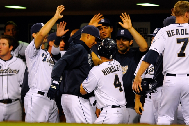Sep 23, 2013; San Diego, CA, USA; San Diego Padres catcher Nick Hundley (4) is congratulated by teammates after hitting a three-run home run during the sixth inning against the Arizona Diamondbacks at Petco Park. Mandatory Credit: Christopher Hanewinckel-USA TODAY Sports