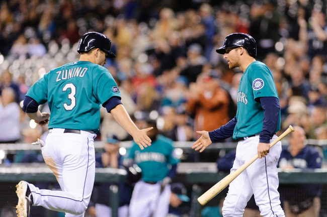 Sep 23, 2013; Seattle, WA, USA; Seattle Mariners catcher Mike Zunino (3) and Seattle Mariners shortstop Brad Miller (5) celebrate after Zunino scored a run against the Kansas City Royals off a RBI single hit by Seattle Mariners second baseman Nick Franklin (20) (not pictured) during the 7th inning at Safeco Field. Mandatory Credit: Steven Bisig-USA TODAY Sports