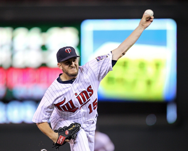 Sep 23, 2013; Minneapolis, MN, USA; Minnesota Twins pitcher Glen Perkins (15) delivers a pitch during the ninth inning against the Detroit Tigers at Target Field. The Twins defeated the Tigers 4-3. Mandatory Credit: Brace Hemmelgarn-USA TODAY Sports