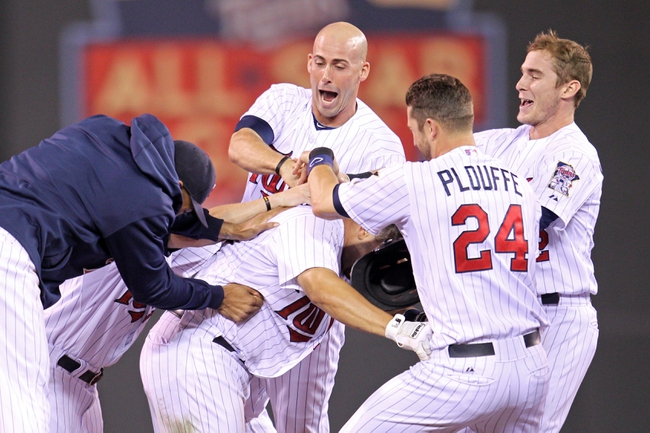 Sep 23, 2013; Minneapolis, MN, USA; Minnesota Twins catcher Josmil Pinto (43) is congratulated by teammates after hitting a walk-off RBI single during the eleventh inning against the Detroit Tigers at Target Field. The Twins defeated the Tigers 4-3. Mandatory Credit: Brace Hemmelgarn-USA TODAY Sports