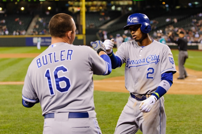 Sep 23, 2013; Seattle, WA, USA; Kansas City Royals designated hitter Billy Butler (16) and Kansas City Royals shortstop Alcides Escobar (2) celebrate after Escobar scored a run against the Seattle Mariners off a RBI single hit by Kansas City Royals second baseman Emilio Bonifacio (64) (not pictured) during the 8th inning at Safeco Field. Mandatory Credit: Steven Bisig-USA TODAY Sports